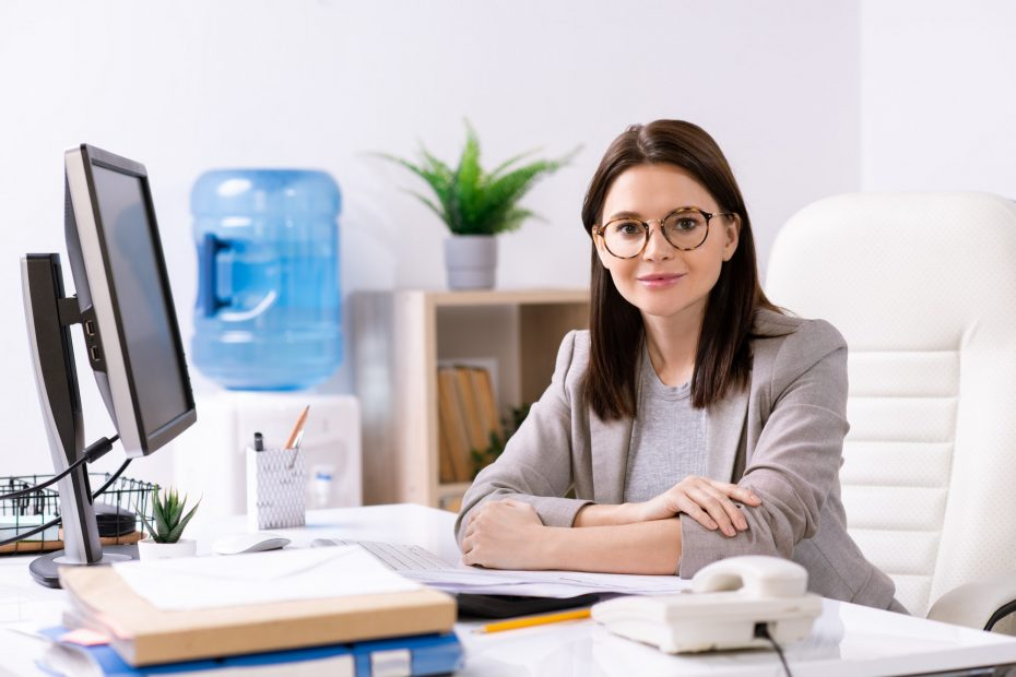 Attractive office manager at desk
