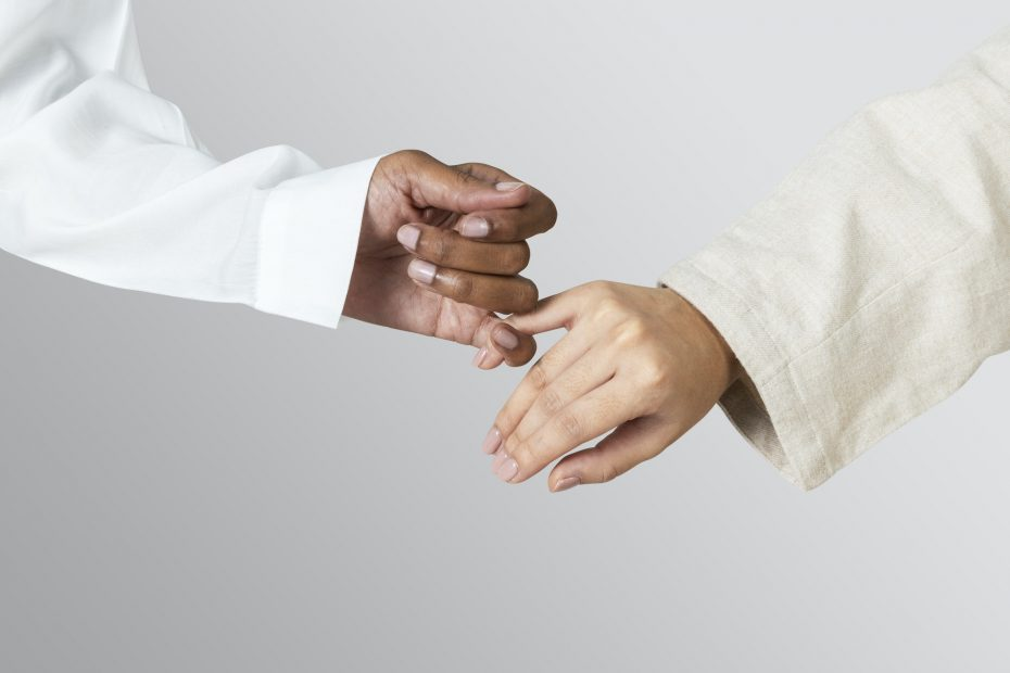 Hands of diversity coming together in unity